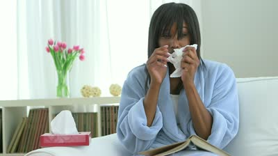 stock-footage-black-woman-with-cold-blowing-nose-into-tissue