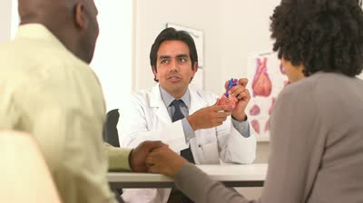 stock-footage-hispanic-cardiologist-with-african-american-couple